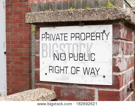 A Public Sign Outside On A Brick Wall Saying Private Property No Public Way Of Right White And Back