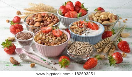 Muesli nuts yogurt and cereals healthy food concept