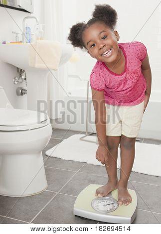African girl weight herself