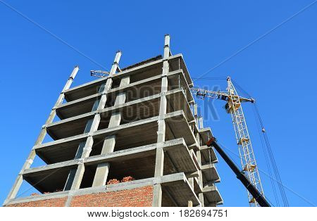 Building under Construction Site. Building a House. Crane and building construction site.