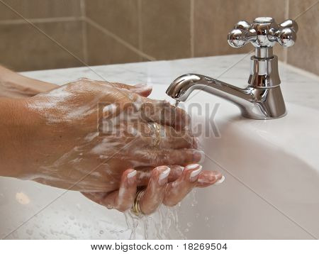 Hands washing in basin clean water