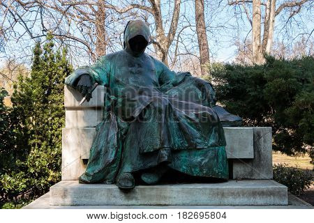 Budapest, Hungary - March 11, 2017: Statue of Anonymous located in city park in the courtyard of Vajdahunyad Castle. This is the first medieval Hungarian chronicler