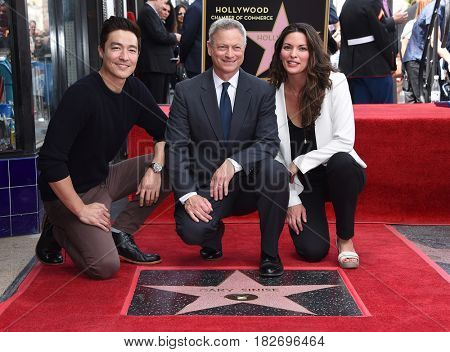 LOS ANGELES - APR 17:  Daniel Henney, Gary Sinise and Alana de la Garza Walk of Fame Honors Gary Sinise on April 17, 2017 in Hollywood, CA
