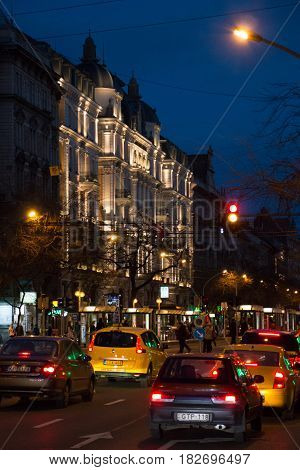 Budapest, Hungary - March 11, 2017: Cars and people city traffic on Erzsebet street in night