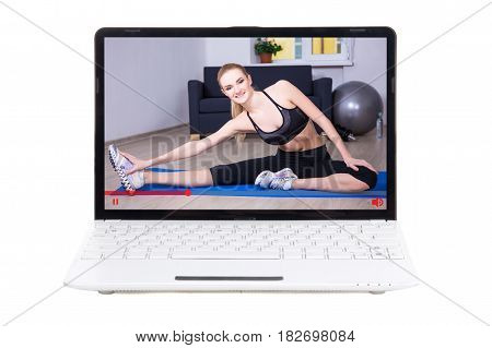 sport blog concept - sporty woman showing her training online in video on laptop screen