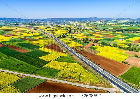 Aerial View Of Road Passing Through A Rural Landscape With Blooming In Northern Greece