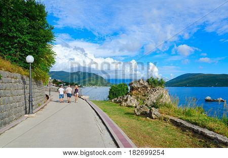 HERCEG NOVI MONTENEGRO - SEPTEMBER 25 2015: Unknown tourists walk along promenade in popular resort town of Herceg Novi Montenegro