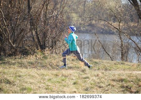 The Boy Quickly Runs On Nature In The Spring