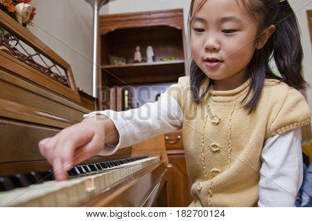Korean girl playing piano