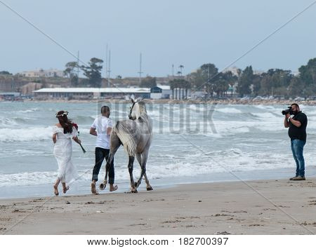 Photographer Takes Pictures Of A Young Couple With A Horse