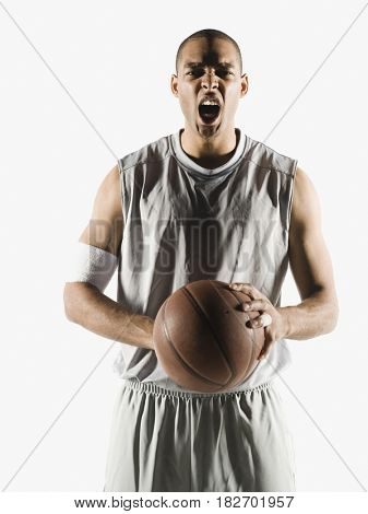 Angry African man holding basketball