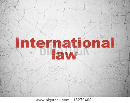 Politics concept: Red International Law on textured concrete wall background