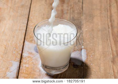 Milk. Image Of Milk .fall Into Glass.
