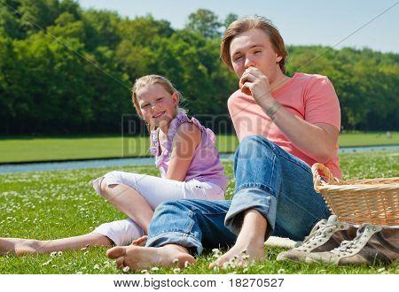 Two Teenagers Having Picnic