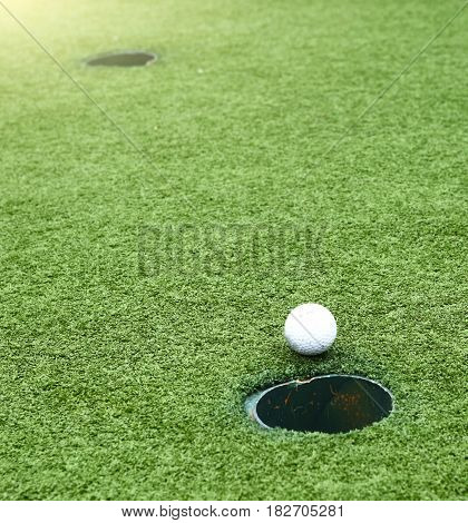 Golf Field Holes With Ball Going To The Trap