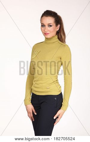 Business Woman With Pony Tail In Yellow Blouse And Black Trousers
