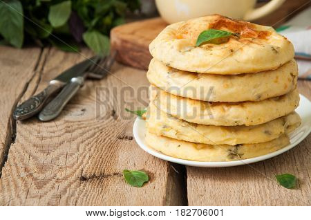 Potato Herbs And Cottage Cheese Small Flat Breads Served On A Wooden Board. Copy Space And Vertical
