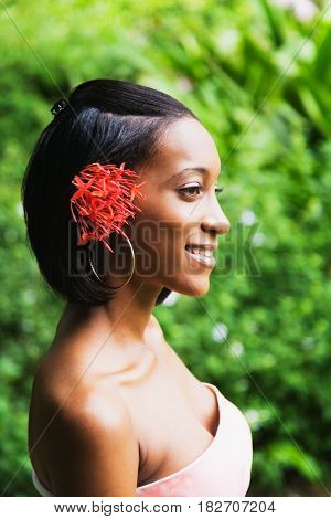 African woman with flowers in hair