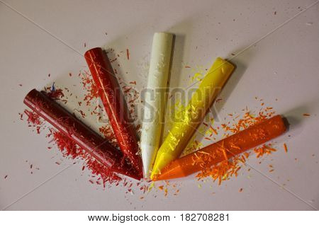 In this image is small, colourful crayons