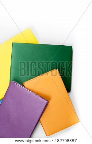 hardback multicolored books on white background. Back to school. Copy space for text