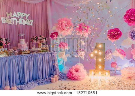 room decoration birthday large paper flowers and a burning unity