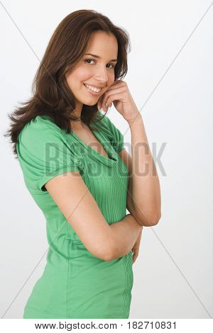 Hispanic woman smiling with head in hands