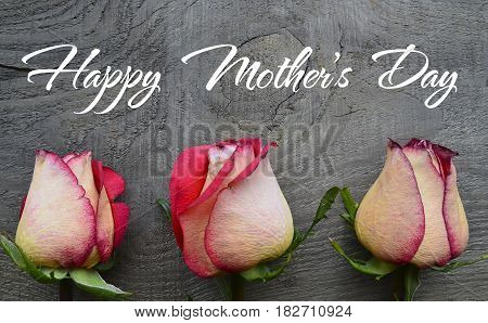Happy Mother's Day.Roses on old wooden background. Mother's Day greeting card.Selective focus.