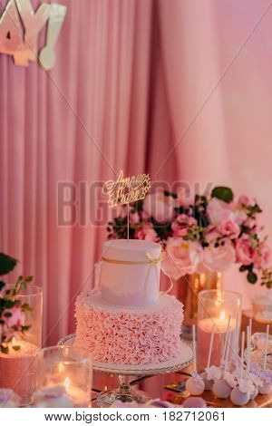 holiday table with a variety of beautiful and delicious sweets and flowers