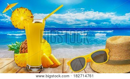 pineapple juice glass pineapple and slices on wooden beach table in sea shore