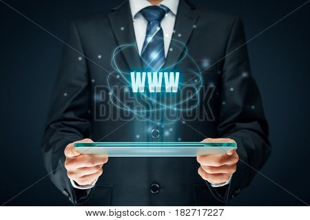 World wide web (www) - internet websites and SEO concepts. Businessman hold futuristic tablet with head-up display and text www.