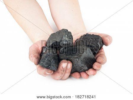 Pieces of coal in hands
