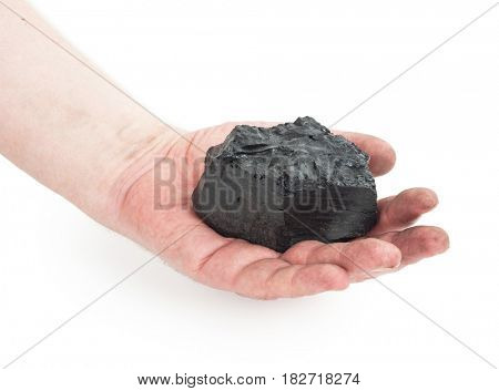 A piece of coal in hand