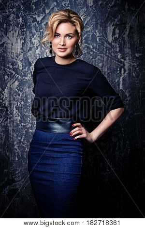 Portrait of a beautiful middle-aged woman in elegant clothes. Business woman portrait.
