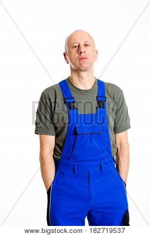 Young Workman In Blue Dungarees