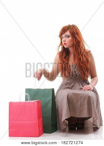 happy girl ginger with shopping bags shoes over white