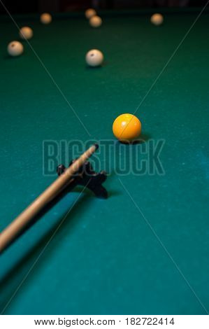 Playing billiard background - cue with white snooker balls on green table.