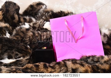 Pink Shopping Holiday Package And Perfume Bottle As Present