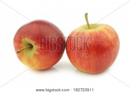 two fresh red and yellow apples on a white background