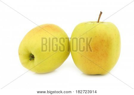 two fresh yellow apples on a white background