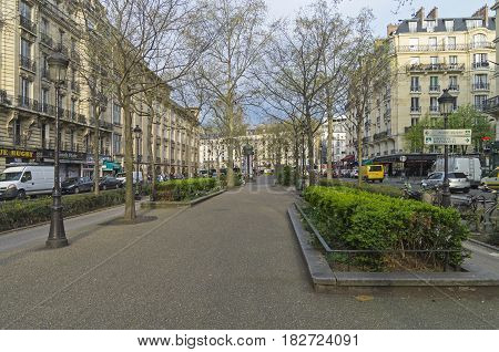 The deserted Parisian boulevard. Boulevard Clichy early in the morning. End of March. Paris France.
