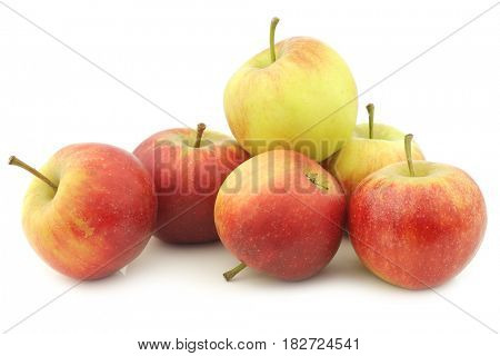 fresh red and yellow apples on a white background