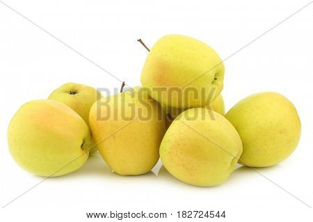 bunch of fresh yellow apples on a white background