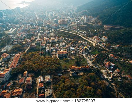 The central part of the modern town of Budva with hotels and high-rise buildings. Aerial view. Europe