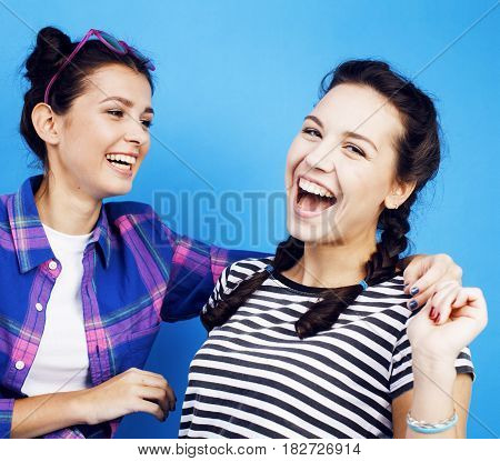 best friends teenage school girls together having fun, posing emotional on blue background, besties happy smiling, lifestyle people concept close up