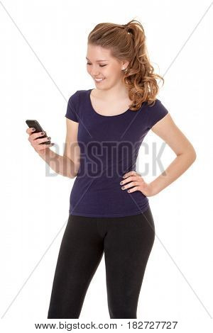 Attractive young woman in sports wear using smart phone. All on white background.