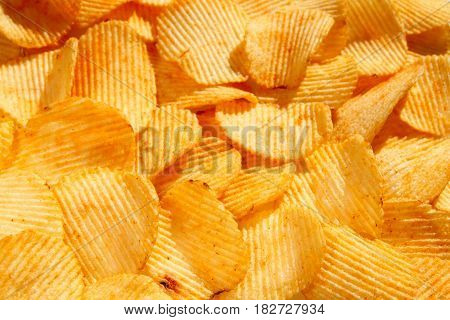 Background Of Golden Wavy Corrugated Chips Large Slices With Seasoning Throughout The Frame, Appetiz