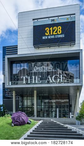 Melbourne, Australia - April 1, 2017: Office Building Of The Age Newspaper With Homeless Person Slee