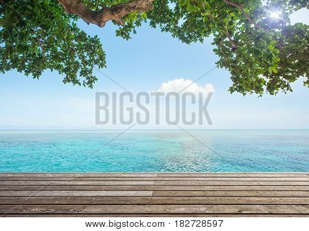 Beautiful seascape with a lonely green island on a sunny day. Beautifull sea nature background.