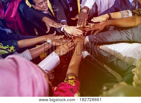 Diverse people hands stack for support together