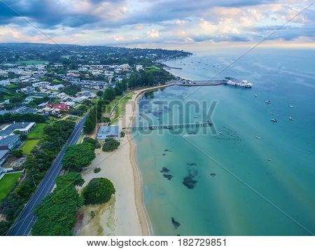 Aerial View Of Sorrento Long Pier, Moored Passenger Ferry And Suburban Houses At Dawn.  Mornington P